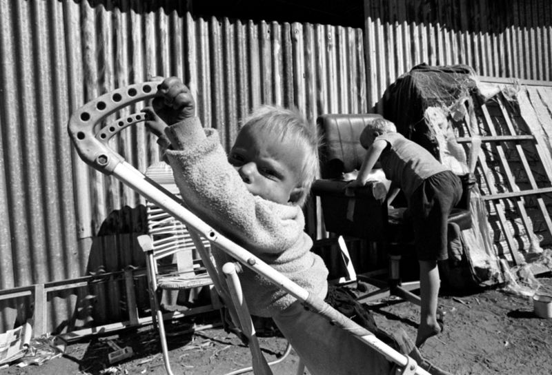 Children play outside their families shack , Gauteng 1998