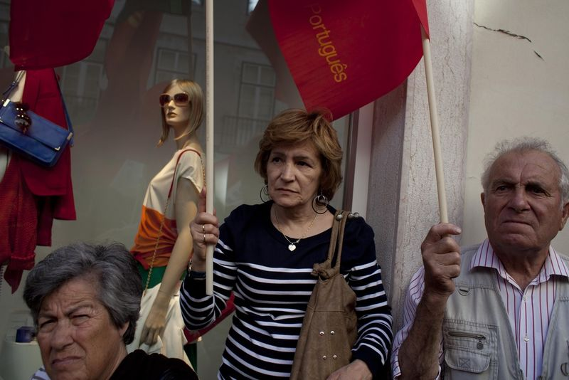 Elderly people attend a communist party rally, denouncing the economic bailout, Saturday, April 9, 2011 in downtown Lisbon, Portugal. (AP Photo/Karel Prinsloo)