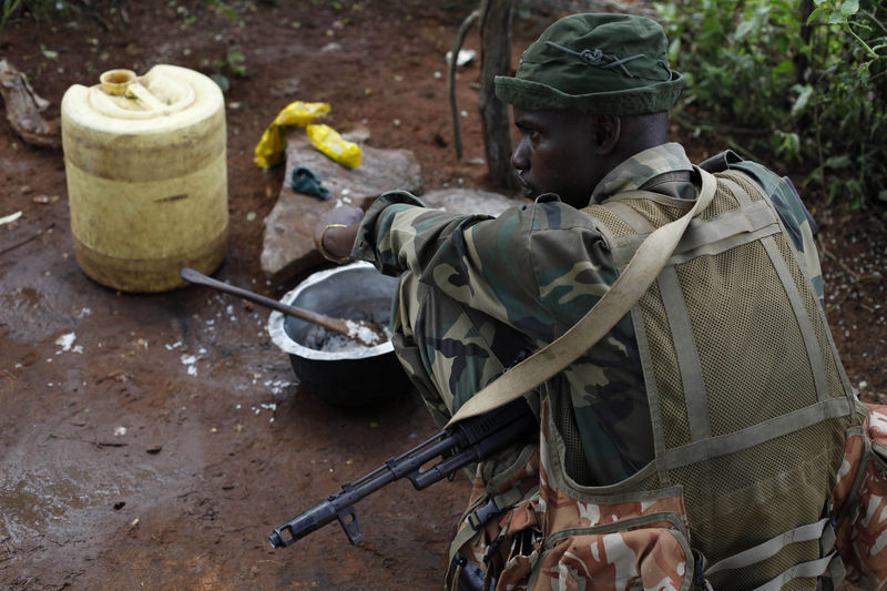 A Kenya Wildlife Ranger eat before they go on patrol looking for poachers in the Tsavo East national park, Tuesday, March 9, 2010 in Kenya.