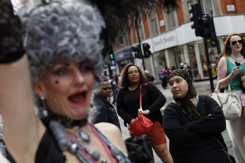 A woman wearing a scarf look on as revellers participate in the annual Gay Pride parade in London, Britain, 07 July 2012. EPA/KAREL PRINSLOO