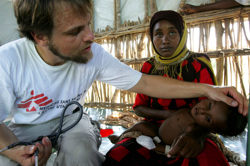 "Anton Breeve form Medecins Sans Frontieres Holland , examine a child with cholera at the Medecins Sans Frontieres hospital near the village of Marere in southern Somalia, Tuesday, Nov.28, 2006 after the Juba river burst its banks. Fears of a looming war in Somalia are hampering relief efforts for up to one million people hit by severe flooding, a senior U.N. official said Friday. Eric Laroche, the U.N.'s humanitarian chief for Somalia, said a ""corridor of peace"" is needed so aid can reach 400,000 people who have fled their homes to escape the worst flooding in a decade.(AP Photo/Karel Prinsloo)"