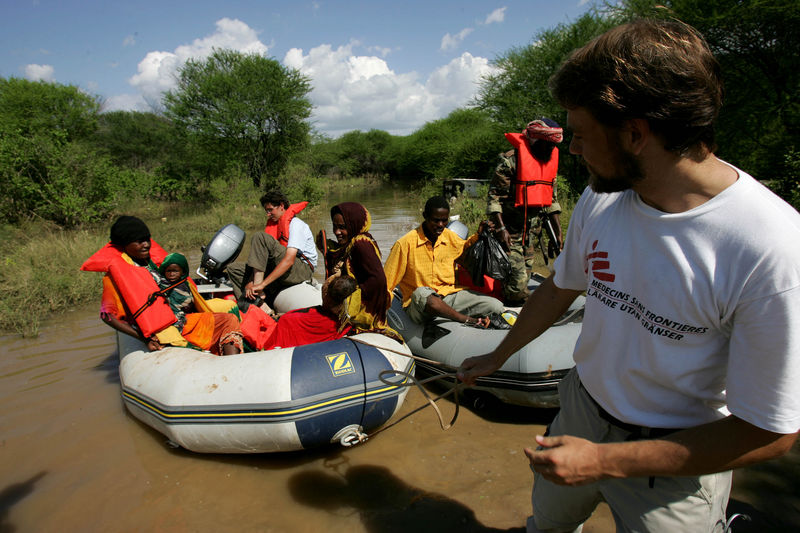"Peter Moberger form Medecins Sans Frontieres Holland pull a boat to shore as they bring two children with cholera to the Medecins Sans Frontieres hospital near the village of Marere in southern Somalia, Tuesday, Nov.28, 2006 after the Juba river burst its banks. Fears of a looming war in Somalia are hampering relief efforts for up to one million people hit by severe flooding, a senior U.N. official said Friday. Eric Laroche, the U.N.'s humanitarian chief for Somalia, said a ""corridor of peace"" is needed so aid can reach 400,000 people who have fled their homes to escape the worst flooding in a decade.(AP Photo/Karel Prinsloo)"