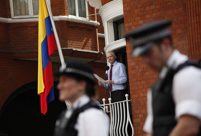 Wikileaks founder Julian Assange delivers a statement on the balcony inside the Ecuador Embassy where Assange has sought political asylum in London, Britain 19 August 2012.  Ecuador granted diplomatic asylum to Wikileaks founder Julian Assange who who took refuge inside the Ecuador's Embassy. EPA/KAREL PRINSLOO