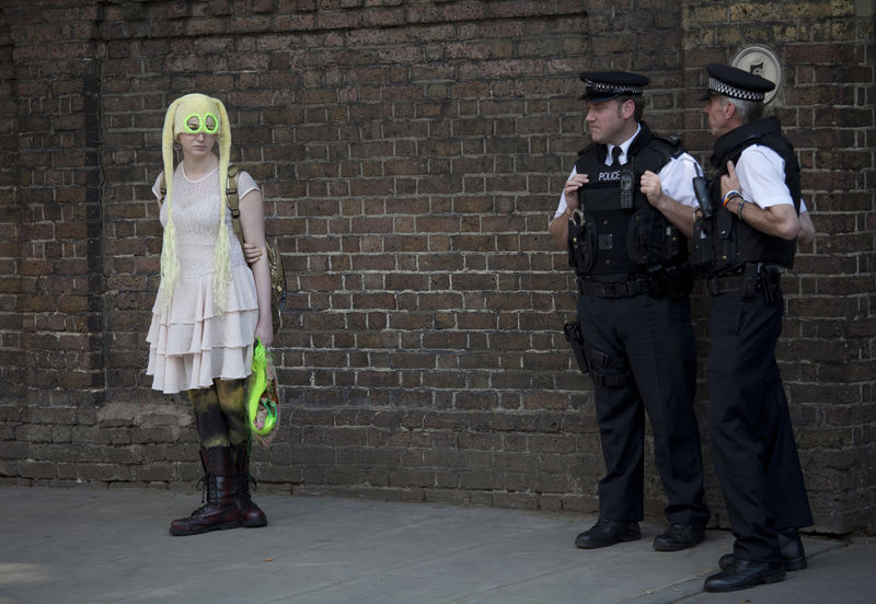 An activists in support of the Russian punk band 'Pussy Riot' stand in front of the Russian embassy as police officers look on in London, Britain, 09 August 2012. The trio is accused of hooliganism in Christ the Savior cathedral against the participation of Vladimir Putin in the presidential elections earlier this year. EPA/ KAREL PRINSLOO