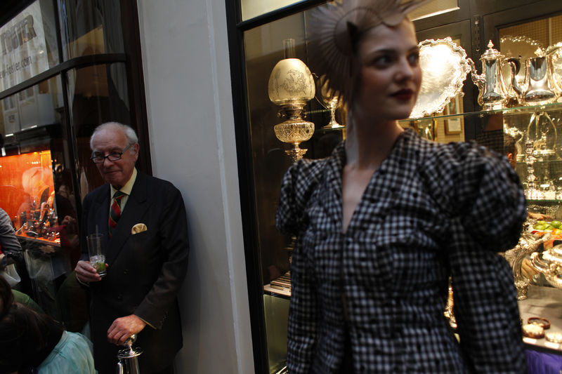A man look on as a model pose at the Burlington Arcade during the Vogue Fashion's Night Out in London, Britain, 06 September 2012. Vogue Fashion's Night Out first started in 2009 under the supervision of the US Vogue editor-in-chief Anna Wintour. EPA/ KAREL PRINSLOO