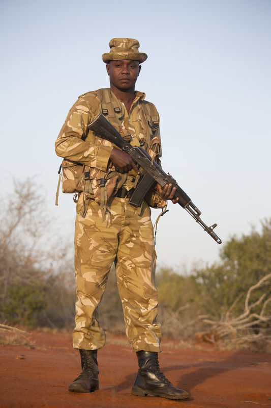 Kenya Wildlife Ranger Nixon Simotwo from the anti poaching unit pose for a picture in Tsavo East game park in Kenya 7 June 2013. PHOTO/KAREL PRINSLOO