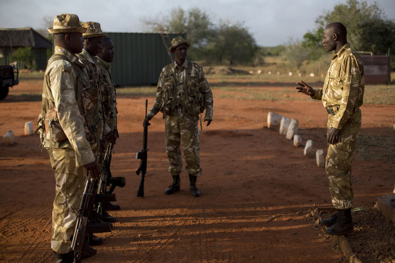 Kenya Wildlife Ranger Sgt. Benson Nadio from the anti poaching unit brief rangers ahead of a patrol at a temporarily base in Tsavo East game park in Kenya 5 June 2013. PHOTO/KAREL PRINSLOO