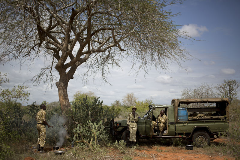 Kenya Wildlife Rangers from the anti poaching unit prepare lunch during a patrol in the Tsavo East game park in Kenya 5 June 2013. PHOTO/KAREL PRINSLOO