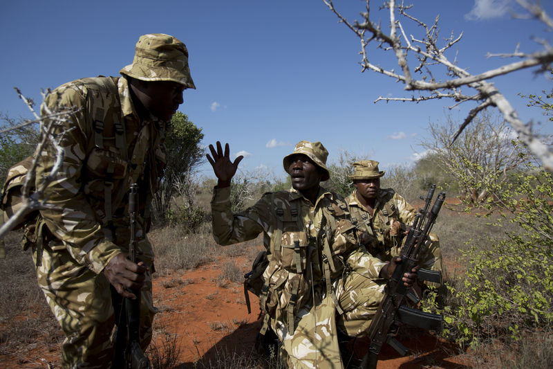 Kenya Wildlife Ranger Sgt. Benson Nadio gesture to fellow rangers as they approach a illegal charcoal sight in the Tsavo East game park in Kenya 9 June 2013. PHOTO/KAREL PRINSLOO
