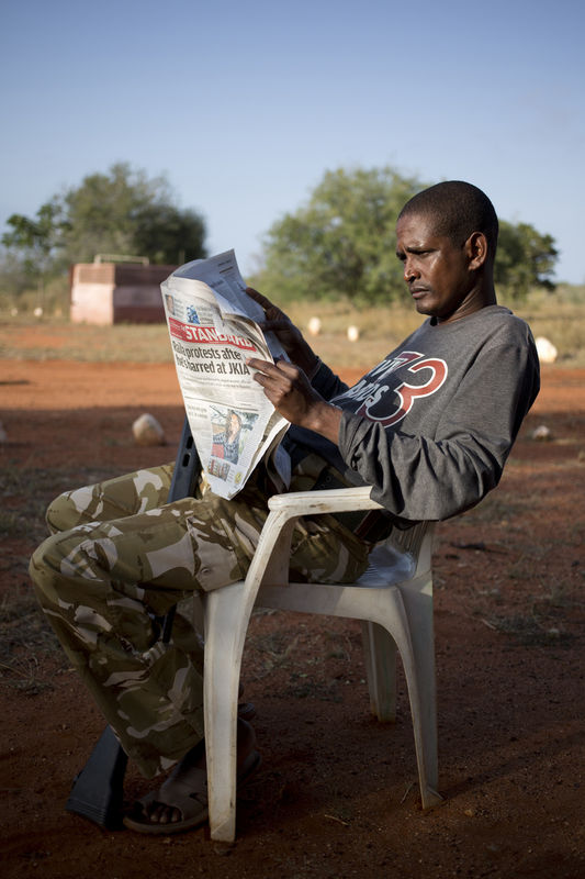 Kenya Wildlife Ranger Nelson Munga from the anti poaching unit relax at a temporally base in Tsavo East game park in Kenya 6 June 2013. PHOTO/KAREL PRINSLOO
