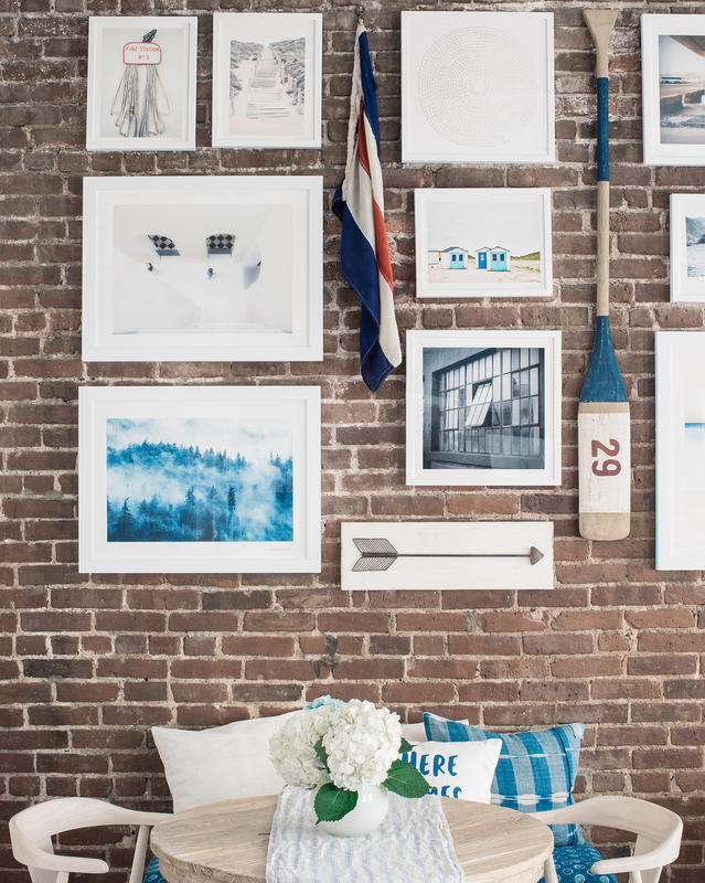 how to hang a gallery wall on exposed brick walls