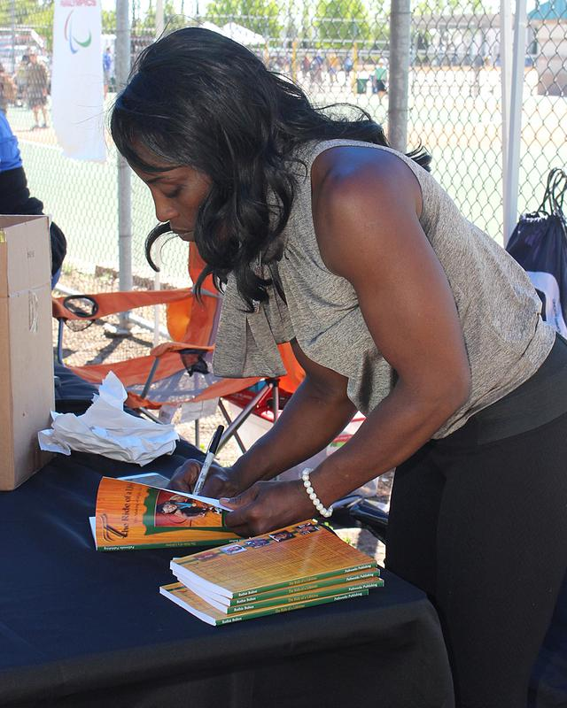 Autographing her book for the participants