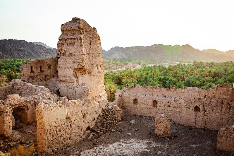 Sunset over the ruins of the Black Fort. Wadi Munqiniyat,