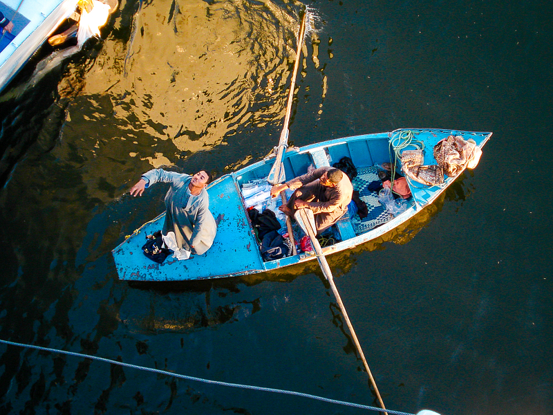 Souvenir vendors doing brisk business with tourists on a Nile cruise ship. Esna lock.