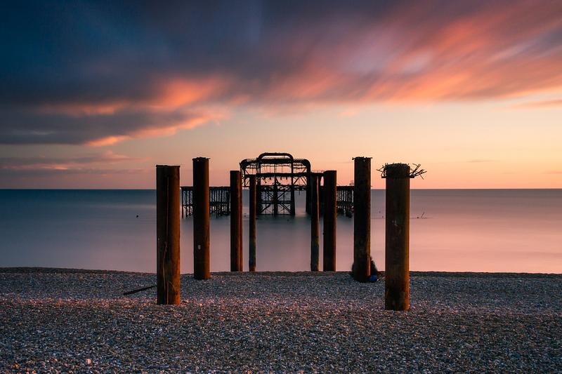 Behind the West Pier sticks at sunset