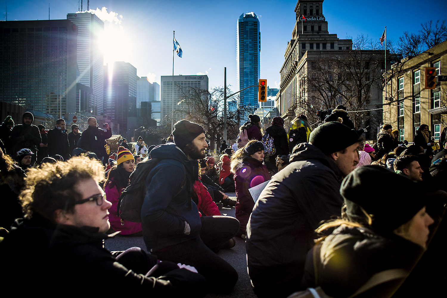 Hundreds of people braved freezing temperatures and gathered in downtown Toronto for a demonstration against President Trump's travel ban on citizens of seven Muslim countries, Monday, January 30, 2017.