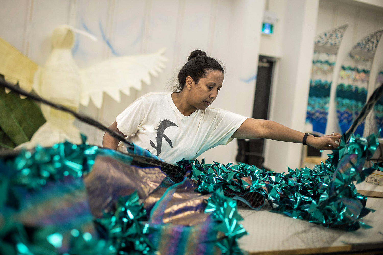 "Michelle Reyes, works on the Queen costume she will wear during the parade. The grade 1 teacher will be playing mas as Queen for Mas-K Club. ""The feeling of being part of something big and the strong sense of community is what makes so many people volunteer their time for the carnival."""