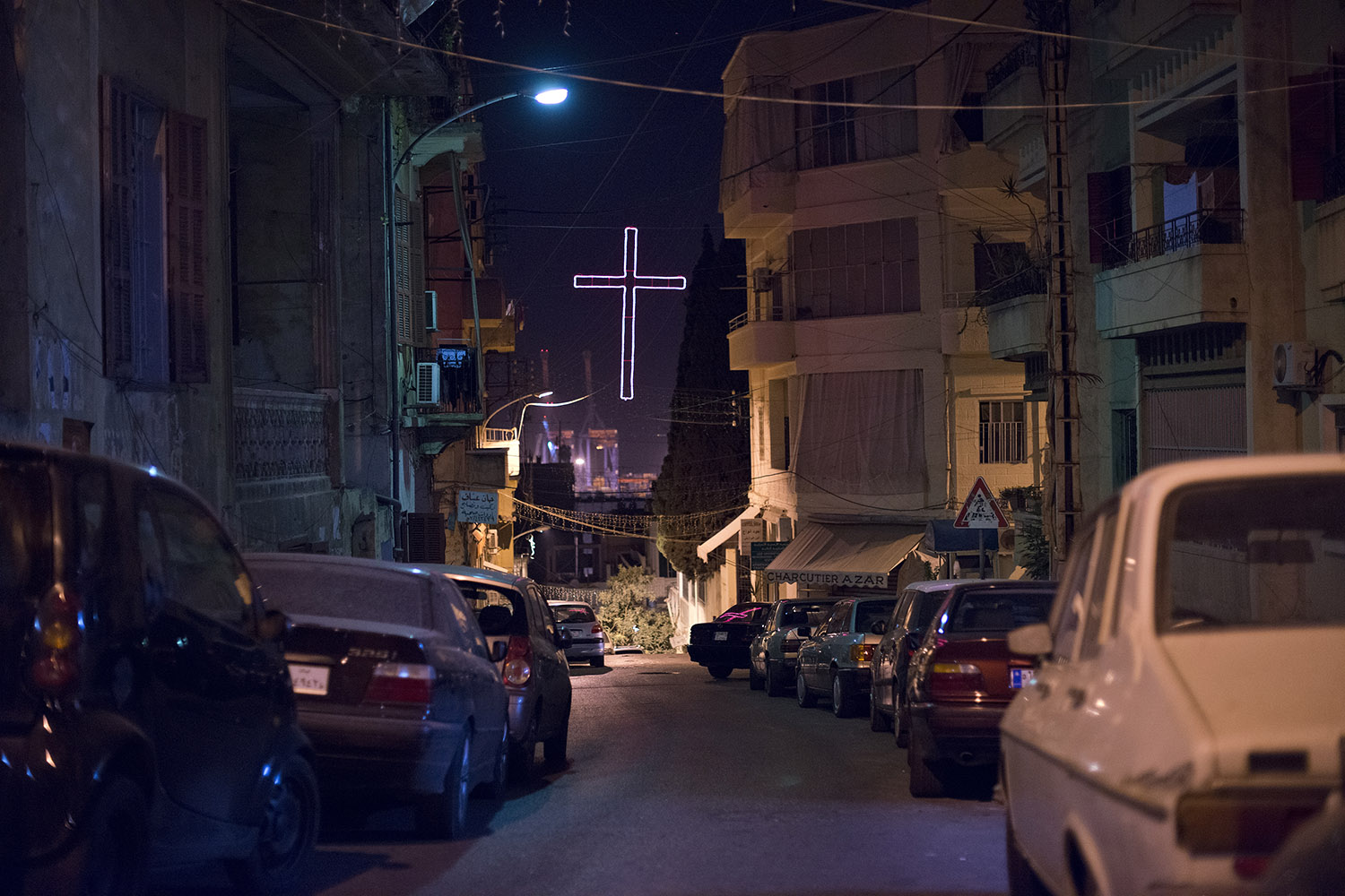 A cross is seen hanging between residential buildings in Beirut, October 6, 2012.