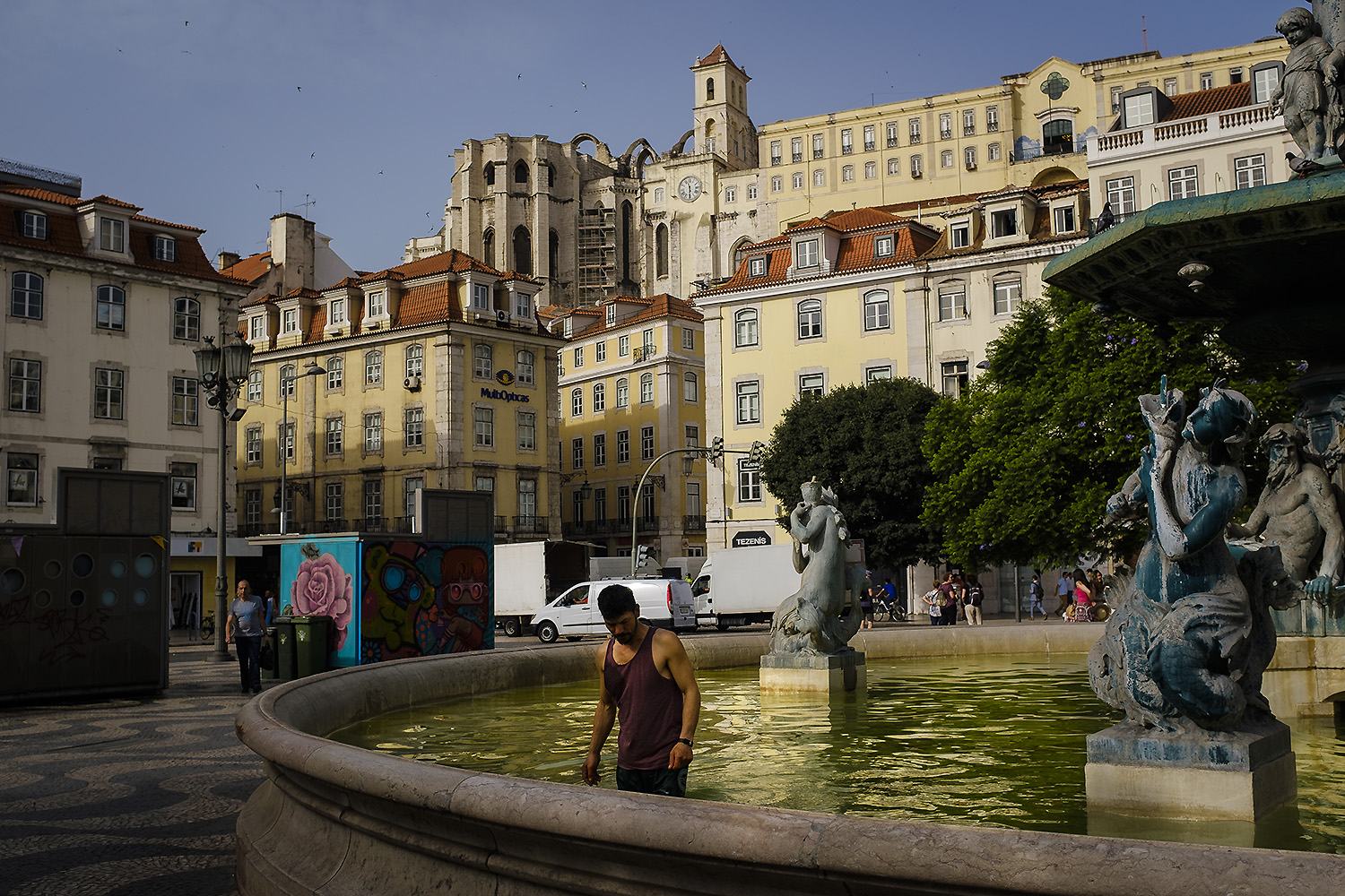 A homeless man refreshes himself inside a water fountain at Rossio Square,  Lisbon, August 2nd, 2018. A heatwave hit Portugal and Spain producing near-record breaking temperatures. Thermometers approached 46 degrees Celsius and Portugal issued red alerts for extreme heat for more than half the country.