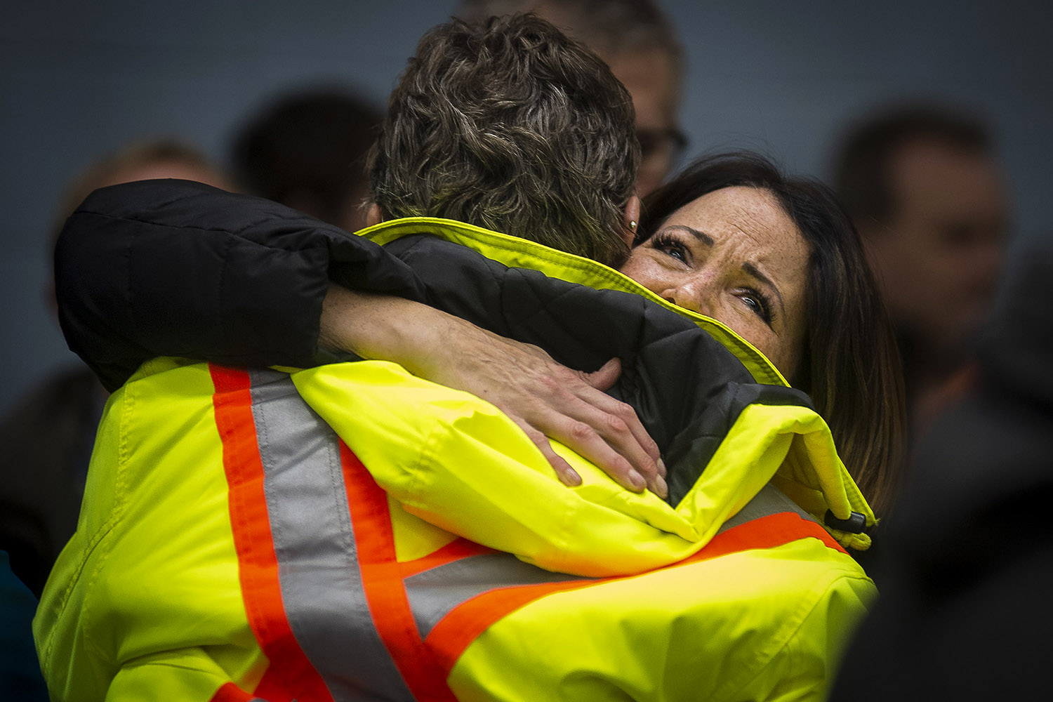 Lianna Hall embraces a colleague as General Motors workers gather at a union meeting in Oshawa after the automaker announced its plans to close the plant, November 26, 2018.