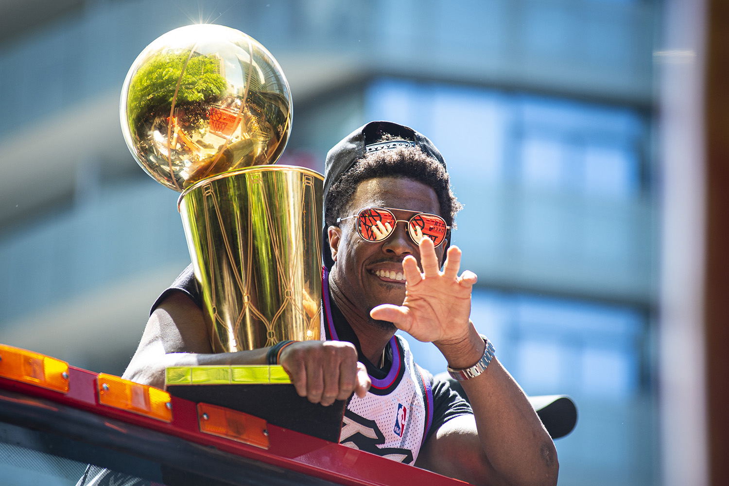Toronto Raptors' Kyle Lowry hold the Larry O'Brien NBA Championship Trophy as the team celebrates its victory in the NBA final with a parade through downtown Toronto, Monday, June 17, 2019.