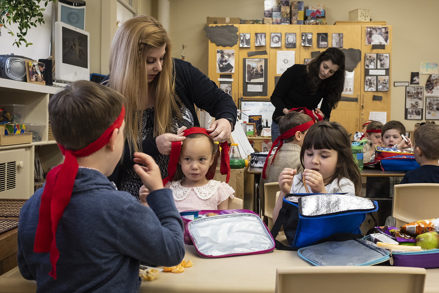 Kindergarten teacher Natalie Miller and early childhood educator Stephanie Rivard help the students with their ninja headbands moments before they leave to visit the elderly residents of Finlandia Village, Sudbury, Friday, May 31 , 2019. Every morning the kindergarten students of Larchwood Public School recite a pledge, tie on their red headbands, and transform into kindness ninjas. Their mission is to perform acts of kindness in their school and within their community.