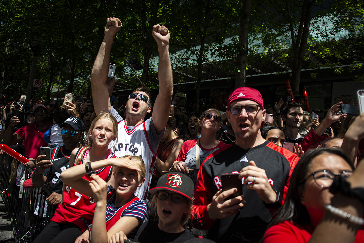 Toronto Raptors' fans watch and cheer as their team parade through downtown Toronto celebrating their first NBA Championship title on, Monday, June 17, 2019.
