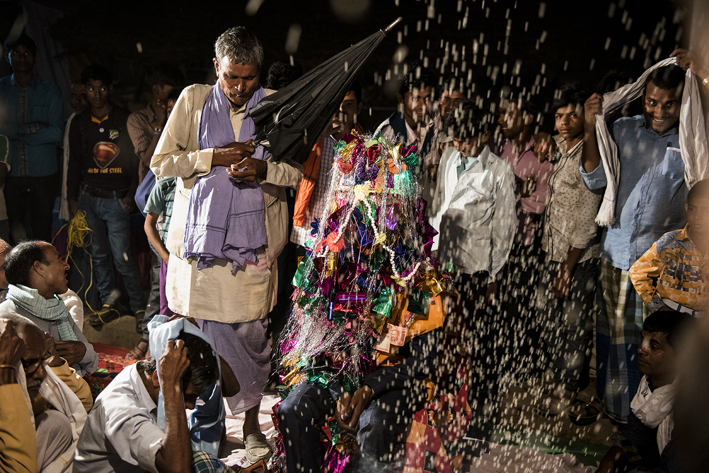 The groom, 21-year old Raju*, is welcomed in the house with ceremonies, as part of which, rice is being showered on him.