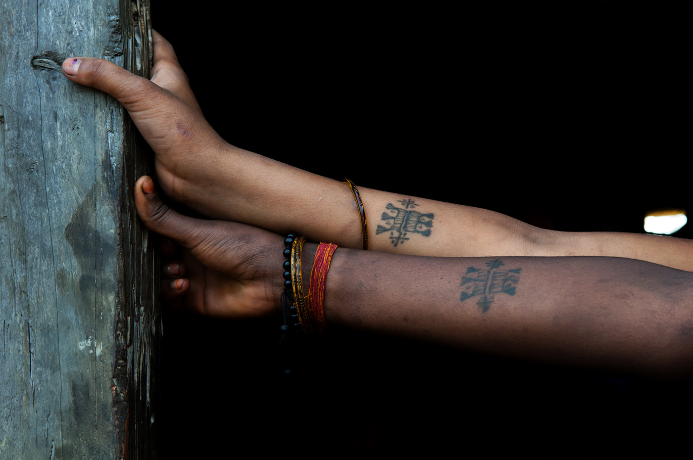 Sheela and Sanju Sonkar place their hands casually over each others. These tattoos are symbolic of the marital status of the girls in certain communities so much so that they are not accepted in their husband's house if they don't wear them.