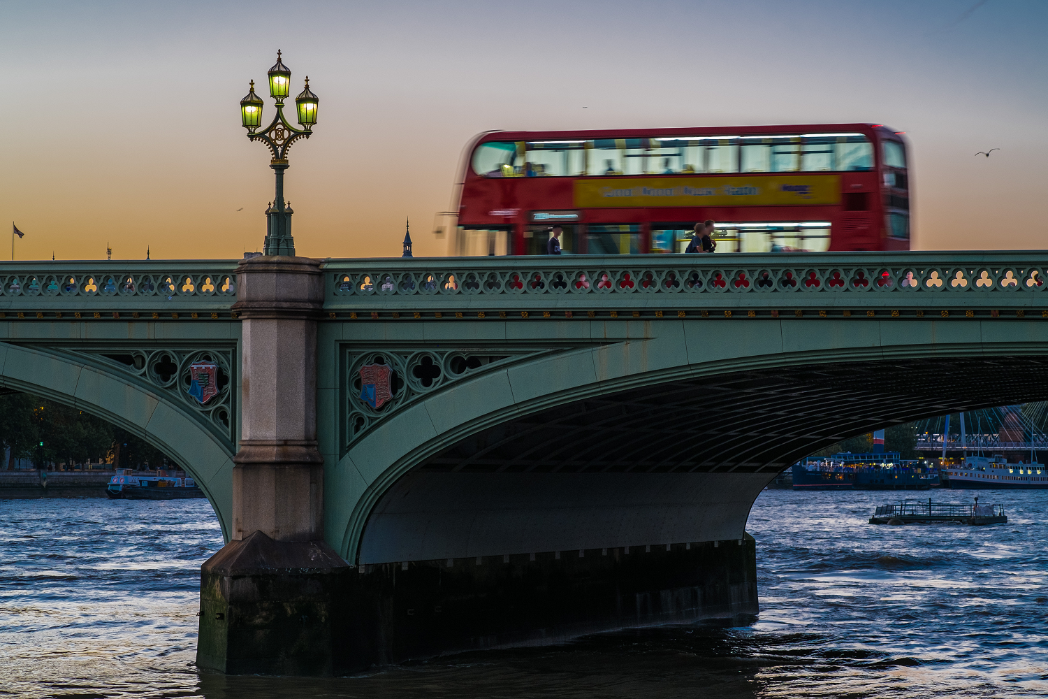 London Bus Crosses Westminster Bridge At Sun Set