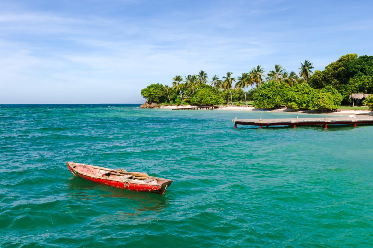 Lonely red boat. Cayo Levantado island. Dominican Republic