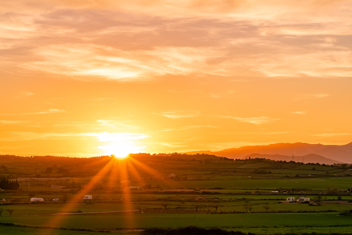 Sunset over Mallorca countryside. Santa Margalida. Balearic Islands