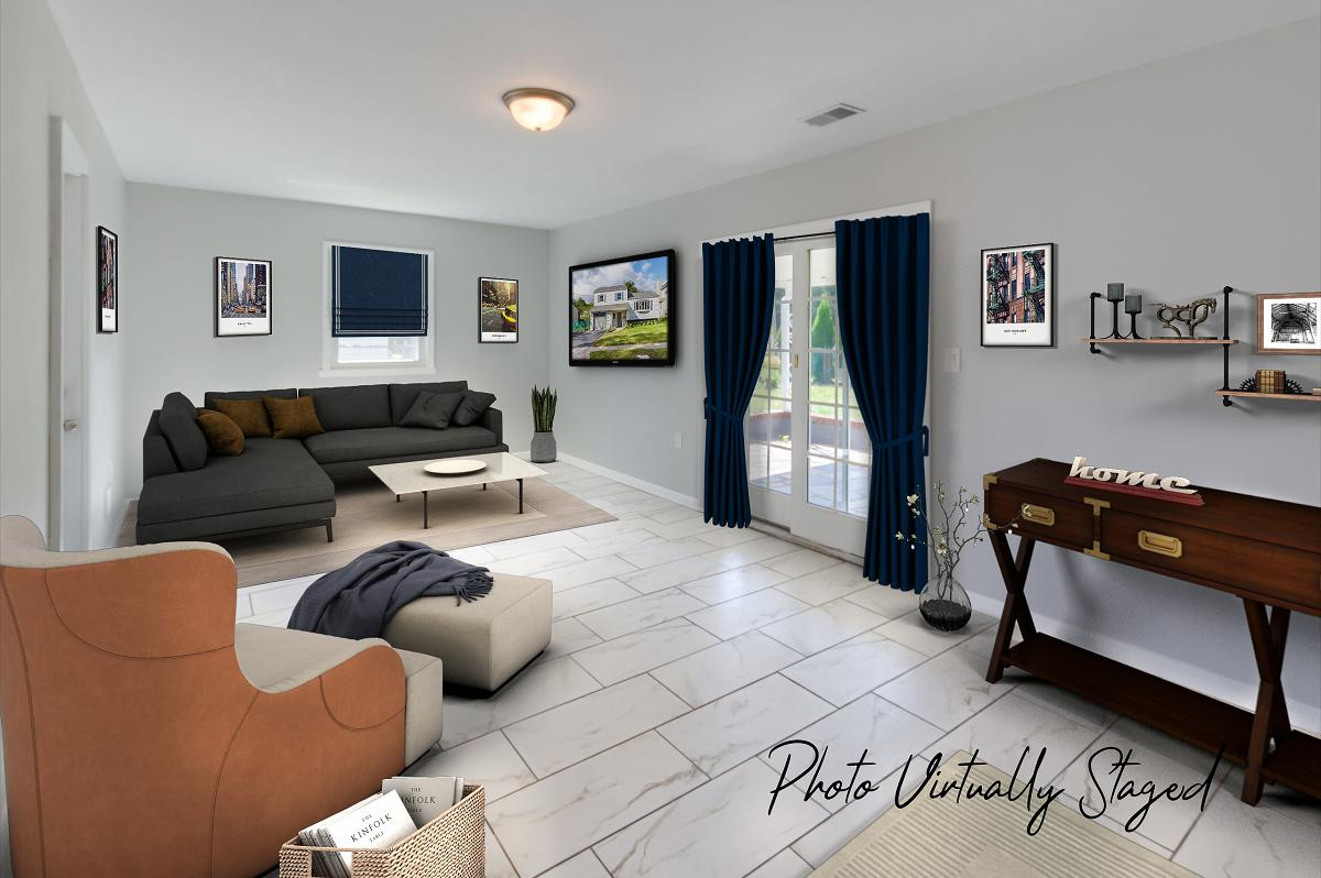 Same room (Family room) but virtually staged by a Fords real estate photographer