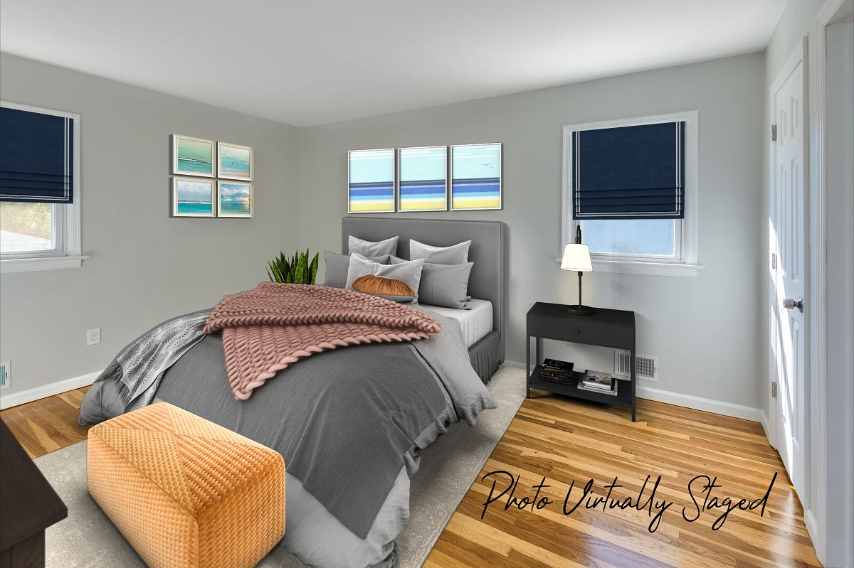 Same room (Master bedroom) but virtually staged by a Fords real estate photographer