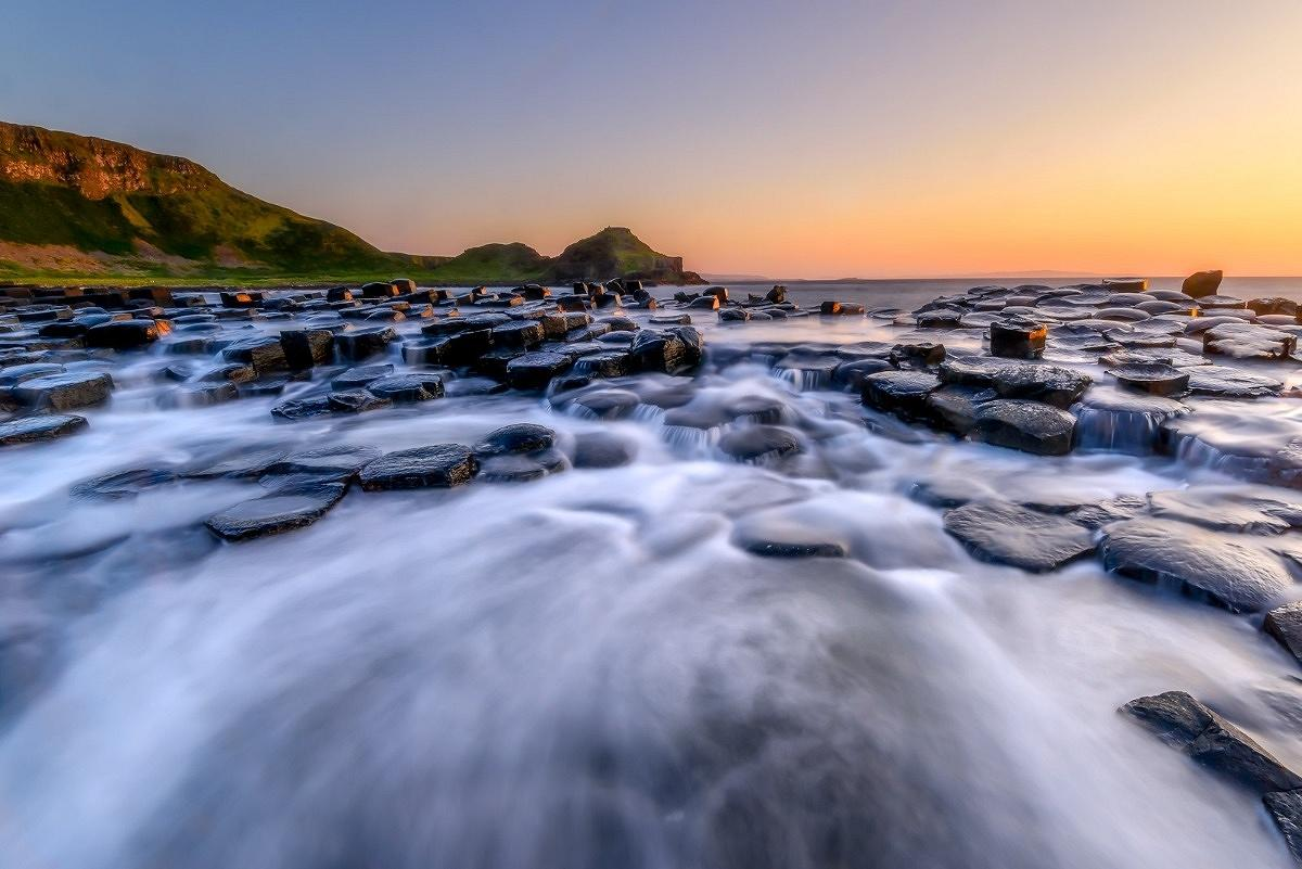 Giants Causeway and the water rushing over the rocks at sunset, these are the style of images we take on my long exposure photography workshops.