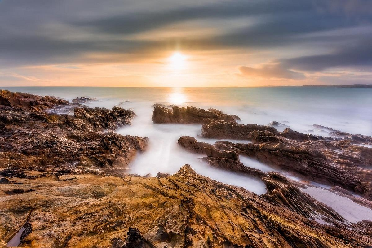 A long exposure photography image taken at sunset showing a seascape like you would see on one of my photography workshops.