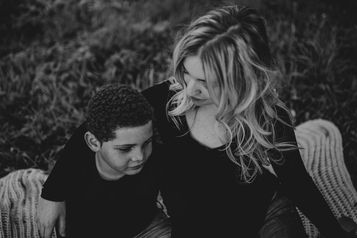 Black and white mother son photo