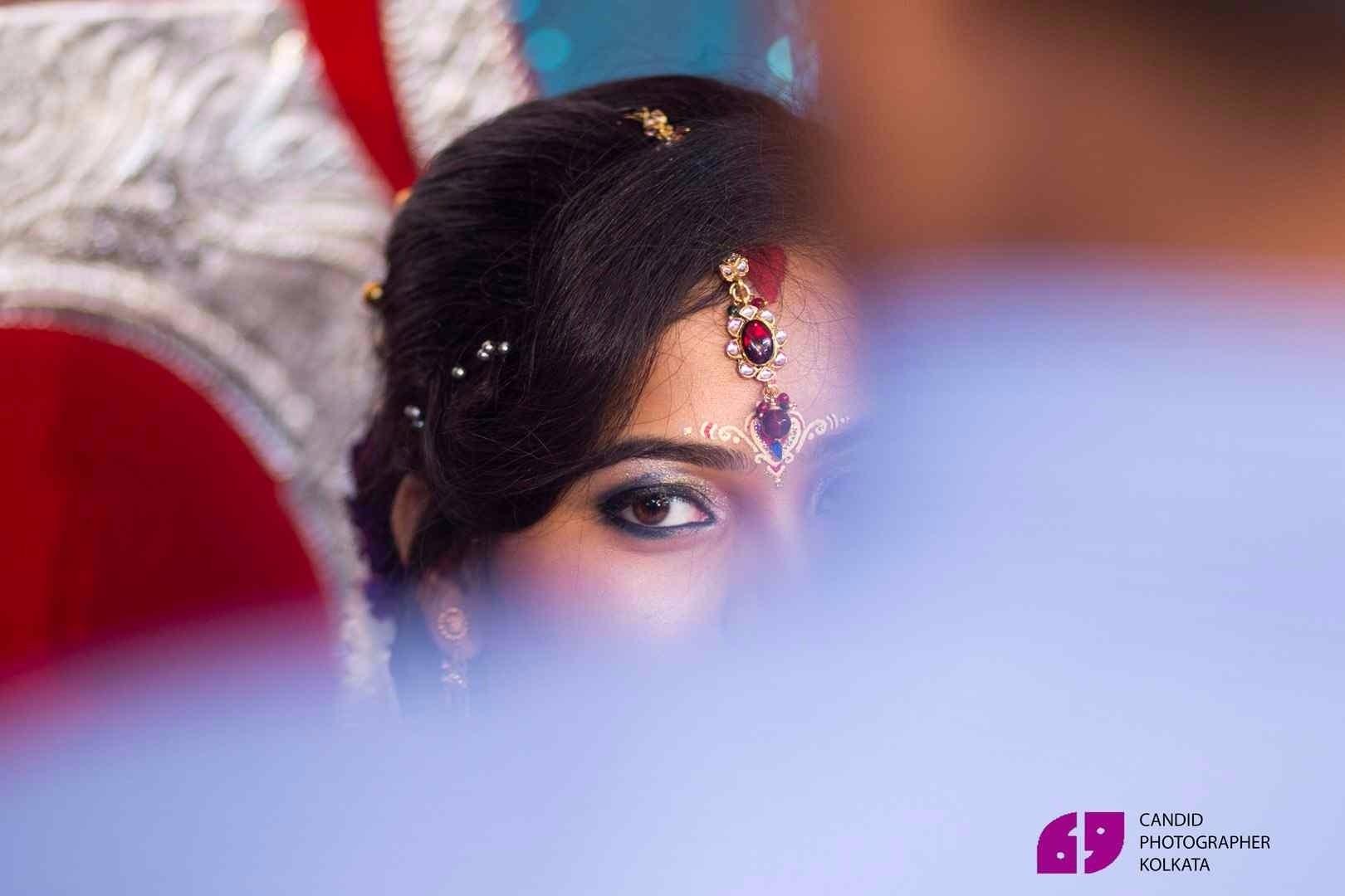best candid wedding photographer in Kolkata