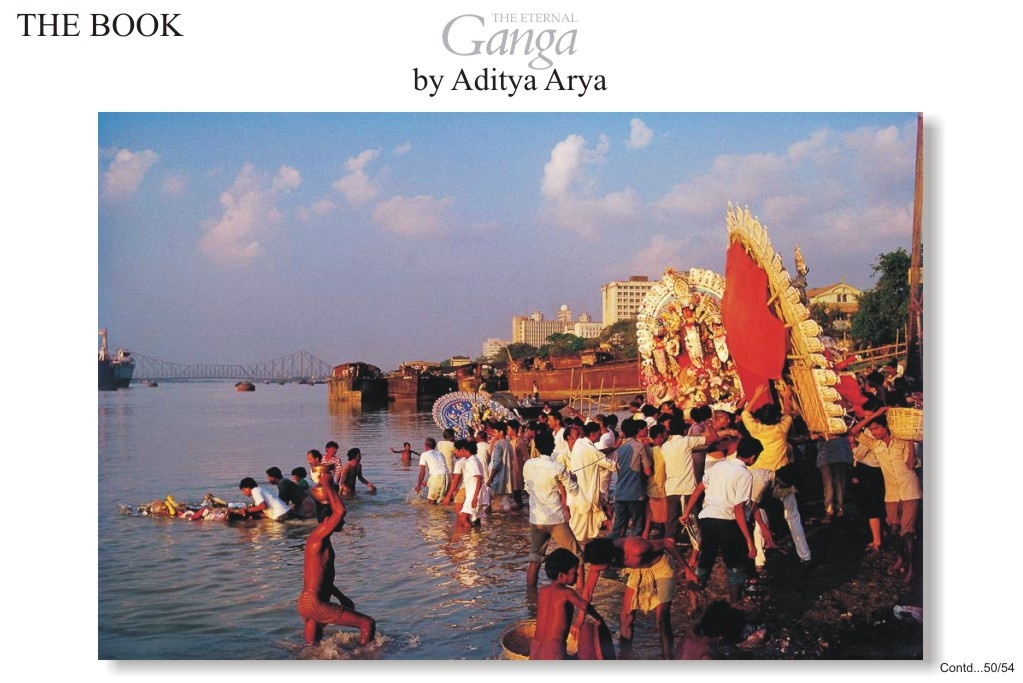 The image of Goddess Durga being taken out in procession for immersion in the river. This ceremony marks the culmination of the Durga Puja celebrations, one of the main festivals of West Bengal.