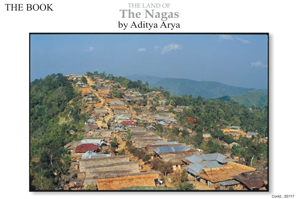 An Ao Naga village lies like an epaulette on the shoulder of a hill.