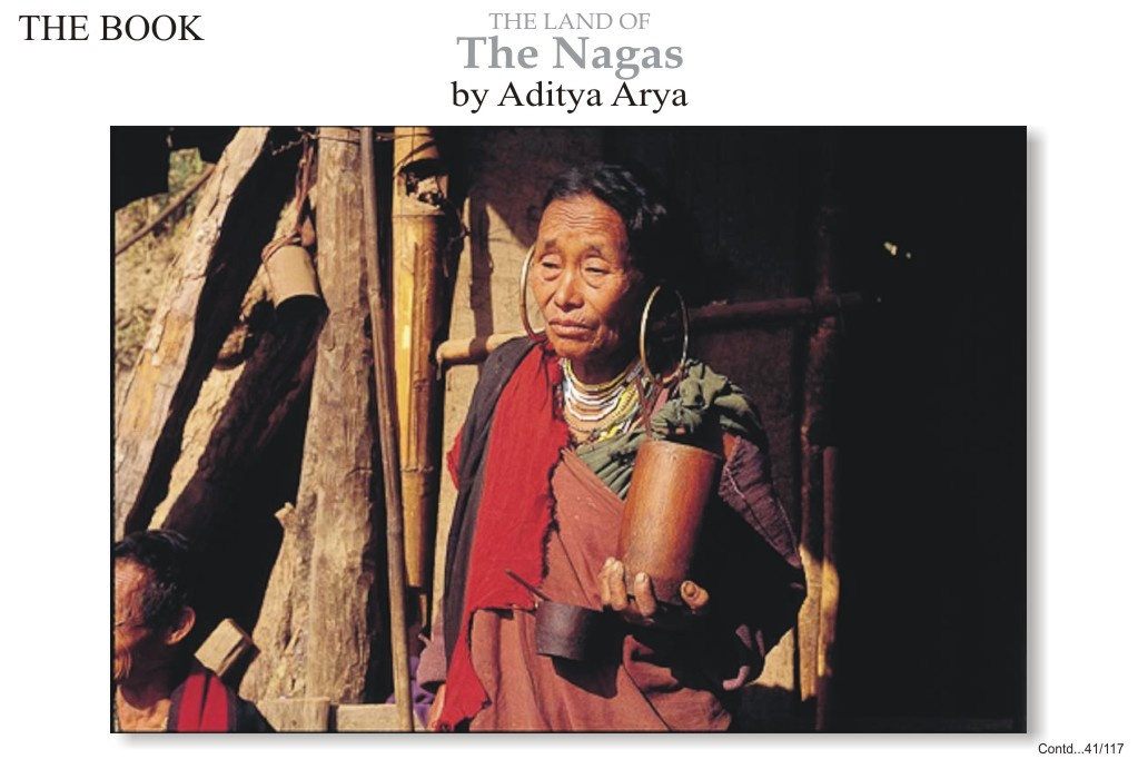 A lady of Losami village in the Phek district is identified as a Chakhesang by her large brass ear rings. She sips zu (rice beer) through a cane straw from her bamboo mug.