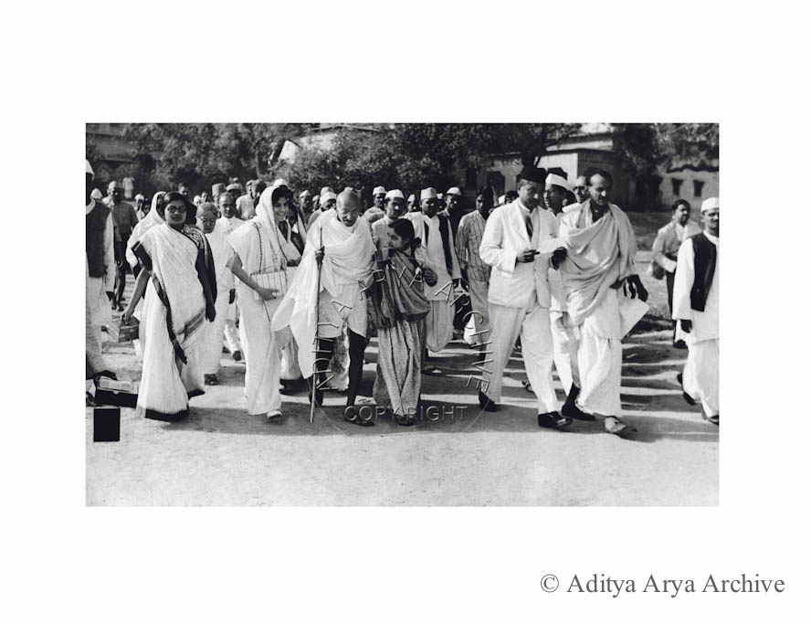 Gandhi ji on the way to inaugurate Kamala Nehru Memorial Hospital, accompanied by Acharya Kripalani, Dr. Jivraj Mehta, Lal Bahadur Shastri and other. 1941