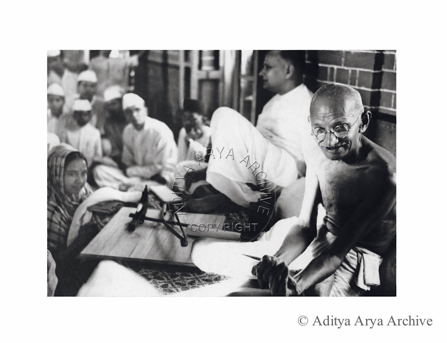 Mahatma Gandhi pleads for alms for the Harijan Fund at New Delhi .Industrialist Jamnadas Bajaj is seated to the left. Early 1940s