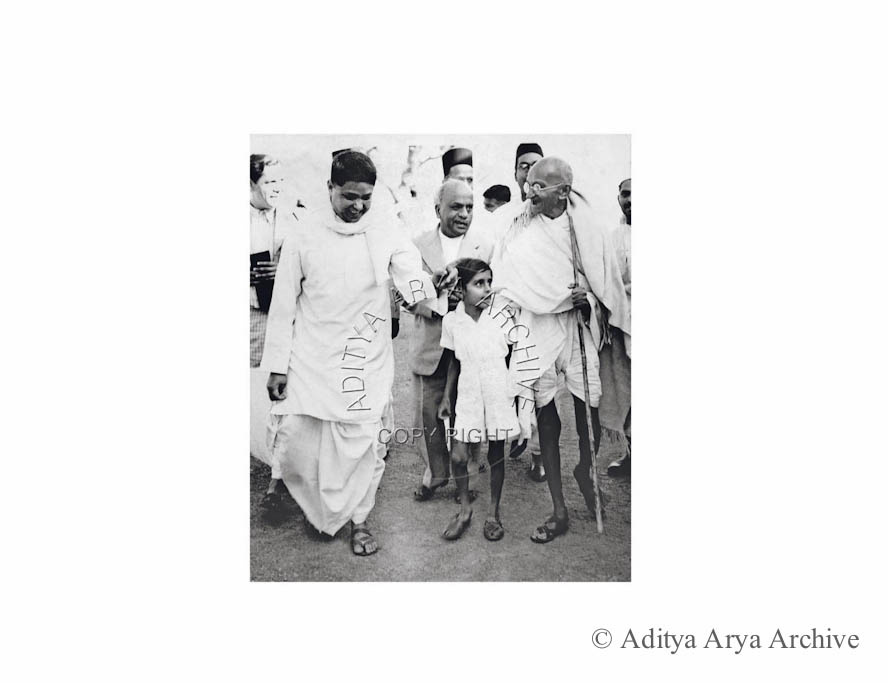 Mahatma Gandhi being greeted at the railway station on his arrival for a meeting With Sir Stafford Cripps at Delhi. On the left is seen Devdas Gandhi.