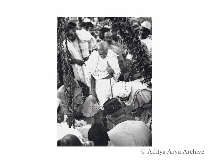 People seeking the blessing of Mahatma Gandhi .Undated