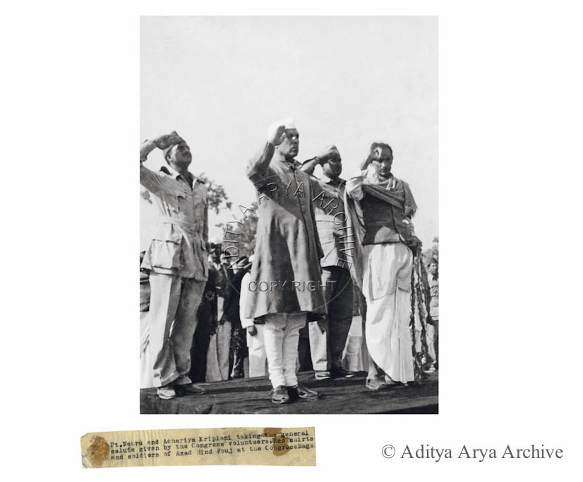 Pt. Nehru and Achariya Kriplani taking the general salute given by the Congress volunteers, Red Shirts and soliders of Azad Hind Fouj at the Congress Nagar.