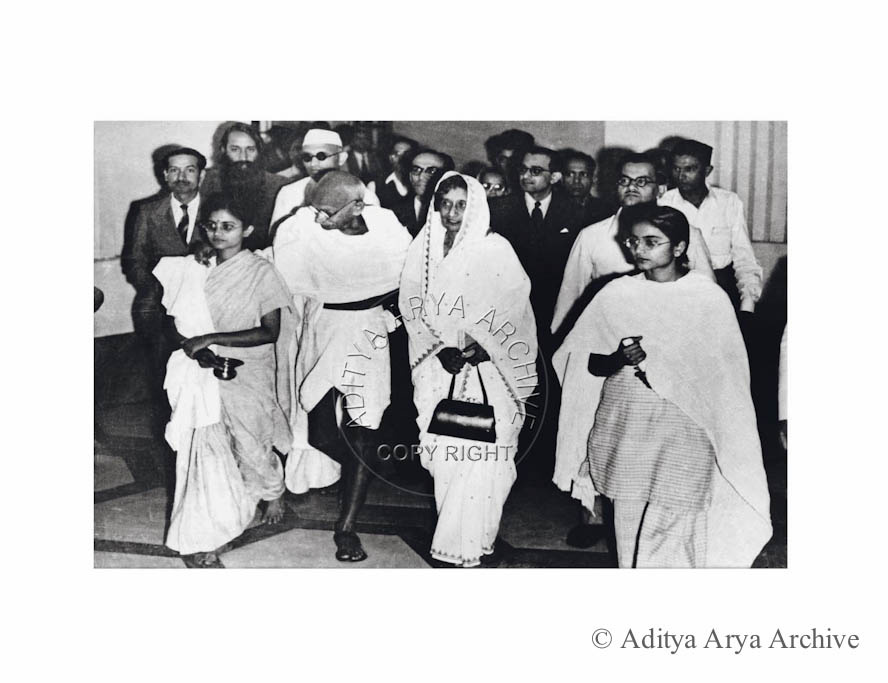 Mahatma Gandhi emerging from Broadcast House .All India Radio, after speaking on the radio for the first. Seen with him is Rajkumari Amrit Kaur.1947
