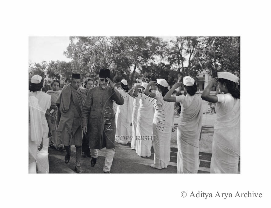 Maulana Azad with a prominent Delhi industrialist being greeted by woman Congress Volunteers. Undated
