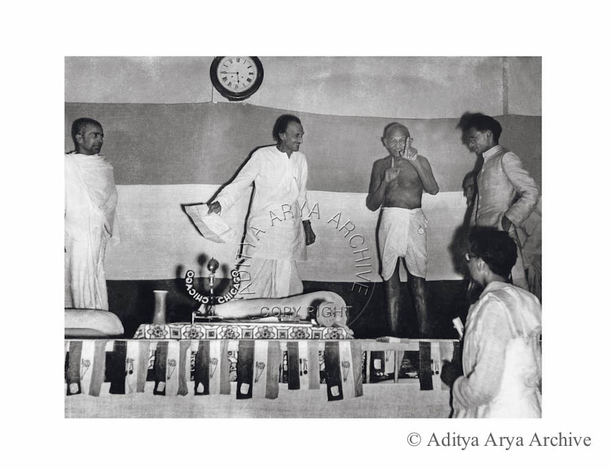 Mahatma Gandhi sharing a joke with Acharya Kripalani and Shankar Rao Deo at the All India Congress Committee session.New Delhi 1946