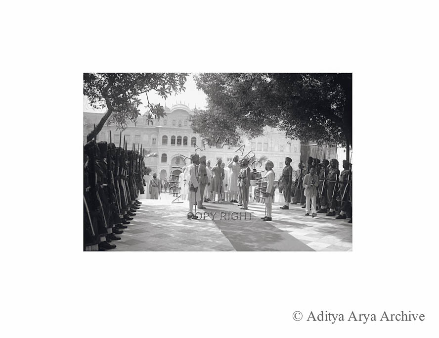 The Maharajas taking the salute before proceeding to the Darbar Hall. 1948